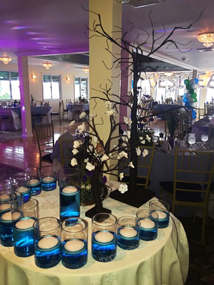Blue water vases sweet 16 candle ceremony