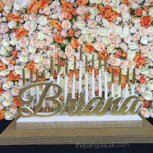 Tiered candelabra and flower wall