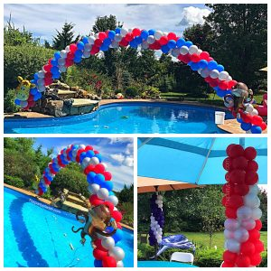 Pool balloon arch with umbrella columns