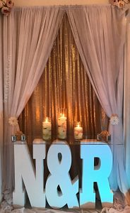 Wedding backdrop with custom initials table