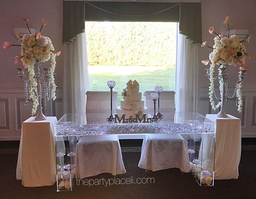 Wedding decor the party place li the party specialists ghost table acrylic wedding sweetheart table junglespirit Image collections